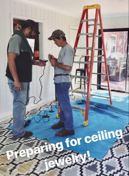 Electricians preparing to install the pendants.