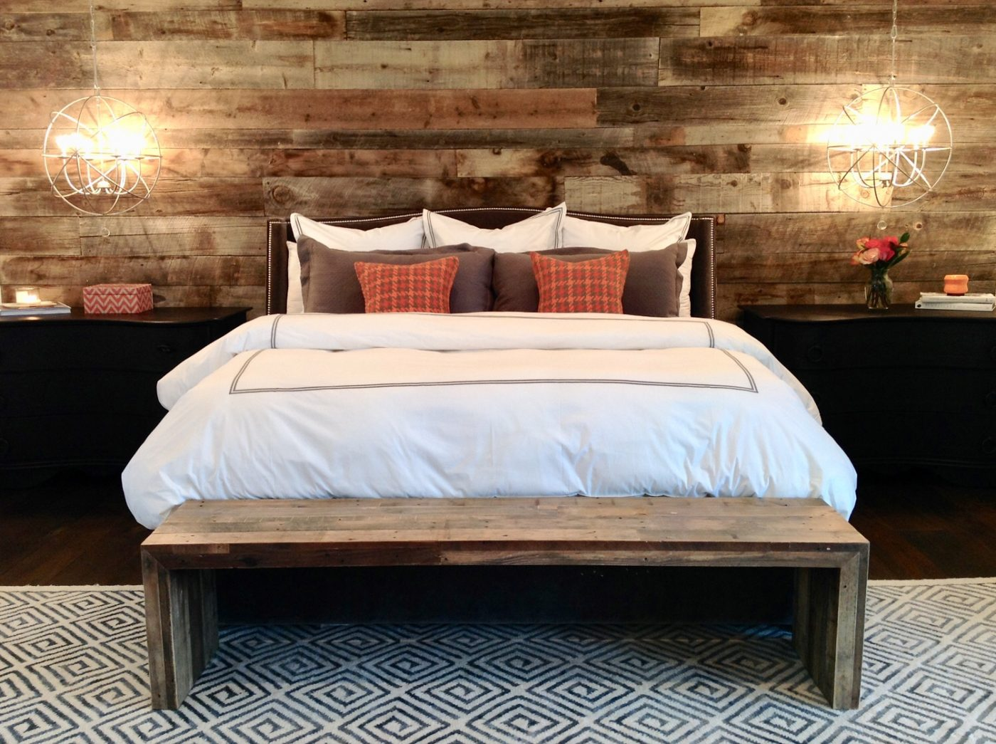 Comfy Cozy Bed! 100 Year Old Barn Wood Wall & Bedside Pendant Lights. I wonder if there is 24 hour room service?