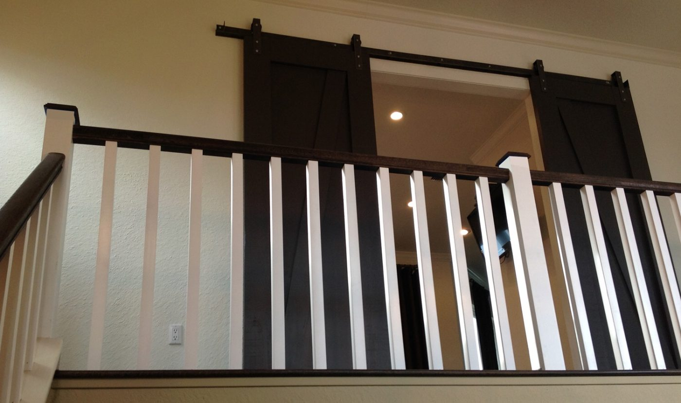 Custom barn-wood doors - Stunning! We salvaged the handrail, and installed new square balusters and newel posts.
