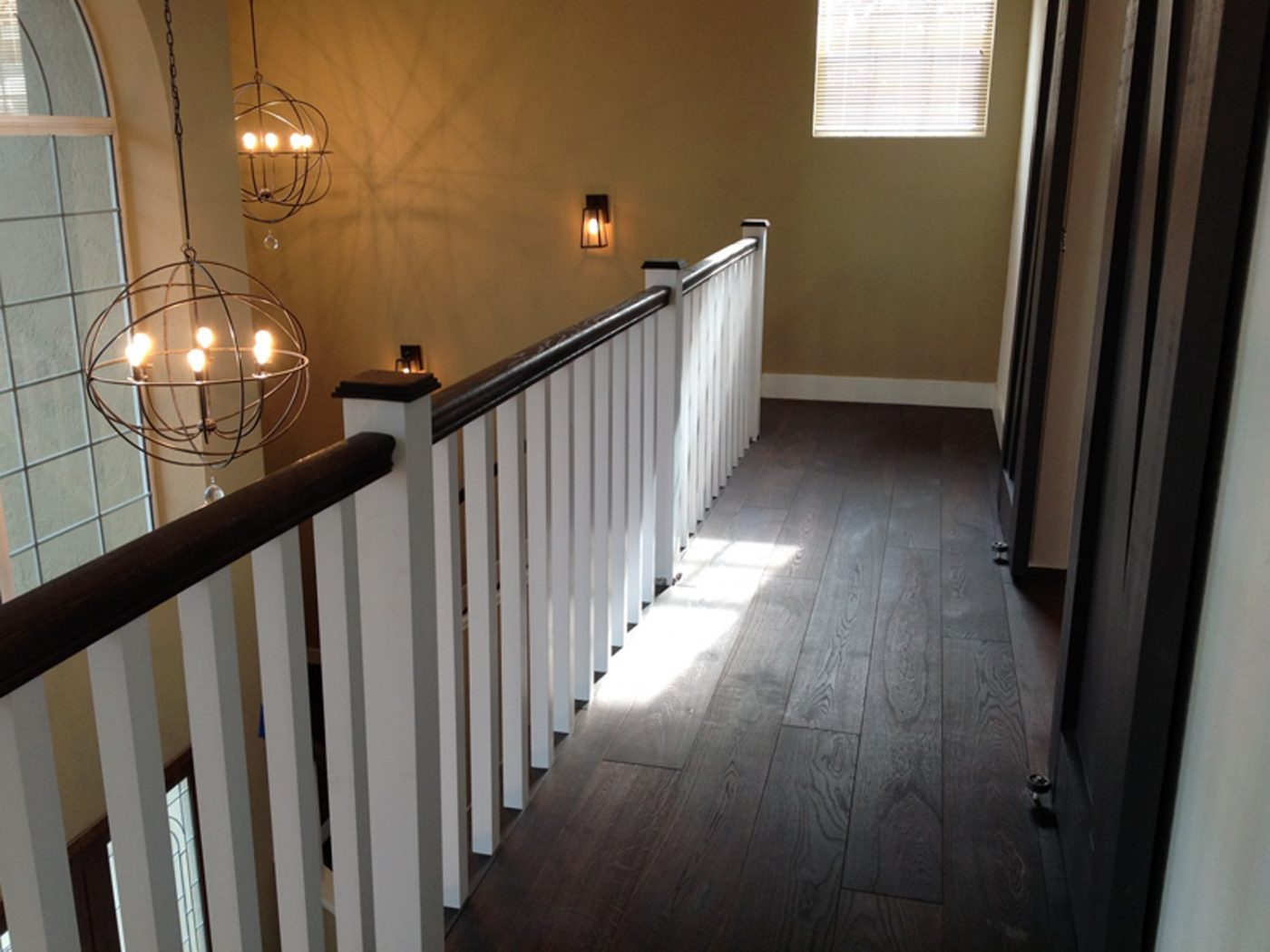 New wood floors, barn doors, railing, and pendant lights!