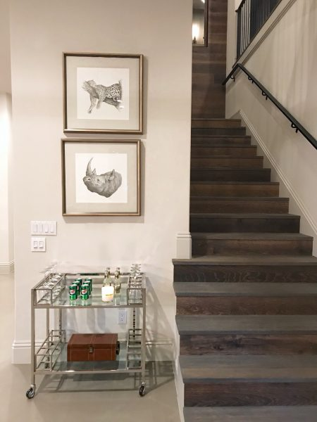 Bar cart in nook created at the base of the stairs.