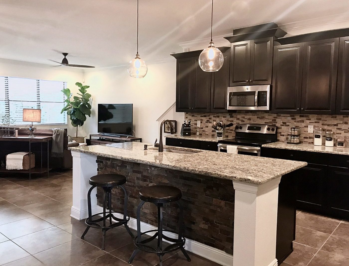 A de-cluttered kitchen and family room made these clients happy.